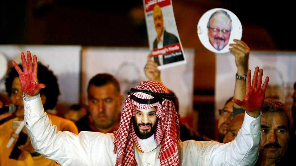 A demonstrator wearing a mask of Saudi Crown Prince Mohammed bin Salman attends a protest outside the Saudi Arabia consulate in Istanbul, Turkey, October 25, 2018.