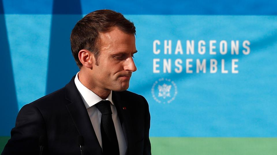 French President Emmanuel Macron leaves after delivering a speech on 'The presentation of the strategy for ecology transition,' at the Elysee Palace in Paris, Tuesday, November 27, 2018.