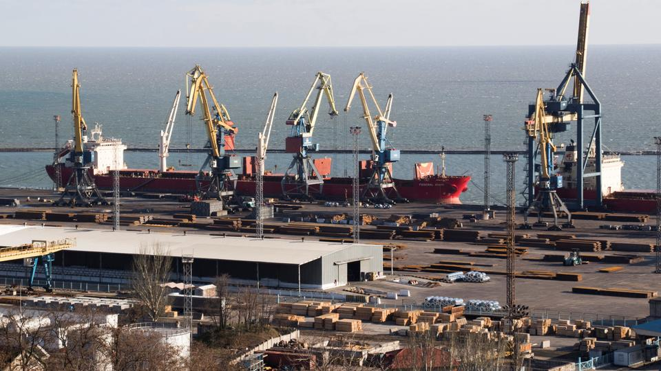 A cargo ship is pictured next to cranes in the Azov Sea port of Mariupol, Ukraine, November 29, 2018.
