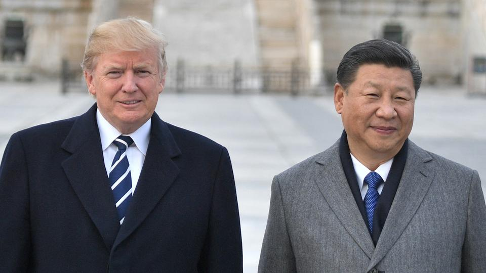 In this file photo taken on November 8, 2017, US President Donald Trump, and Chinese President Xi Jinping pose at the Forbidden City in Beijing.