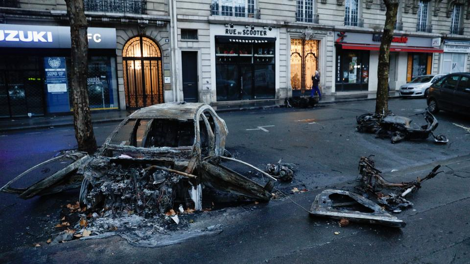 A picture shows a burned car a day after a Yellow vests (Gilets jaunes) demonstration against rising oil prices and living costs, on December 2, 2018 in Paris.