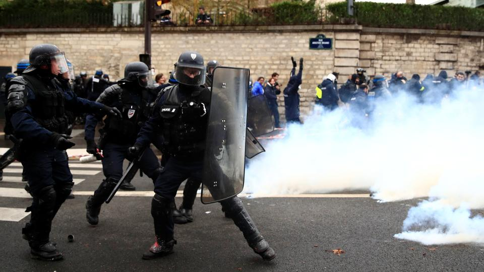 French riot police take position during clashes with French ambulance drivers as part of a demonstration at the Place de la Concorde in Paris, France, December 3, 2018.