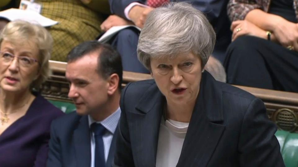 Britain's Prime Minister Theresa May speaks during the scheduled Prime Minister's Questions time in the House of Commons, in London, December 5, 2018.