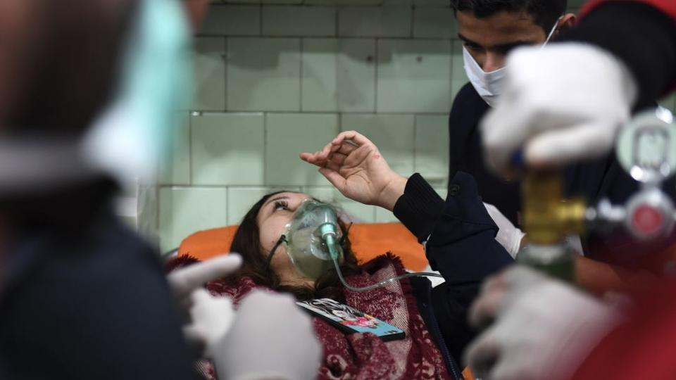 A Syrian woman receives treatment at a hospital in the regime controlled Aleppo on Nov. 24, 2018.
