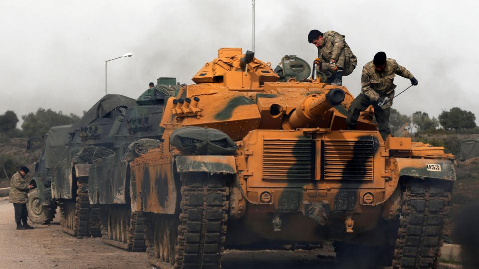 Erdogan said Turkish operations to the east of the Euphrates River against YPG will start soon. Turkish Army officers stand next to their tank at a staging area close to the border with Syria in January 2018 during Turkey's Operation Olive Branch against YPG's northwestern enclave of Afrin.