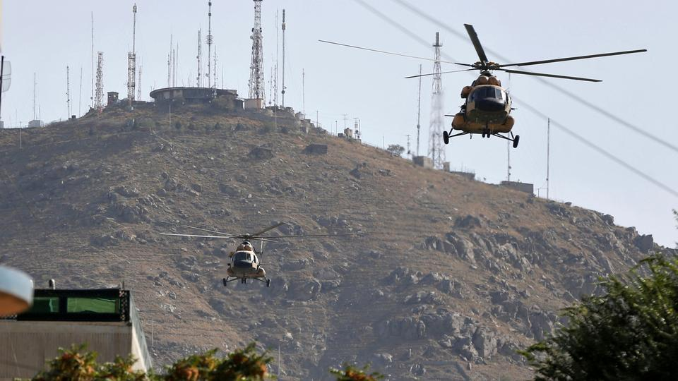 Afghan Air forces helicopters fly over the site of a suicide attack followed by a clash between Afghan forces and insurgents during an attack on Iraq embassy in Kabul, Afghanistan, on July 31, 2017.