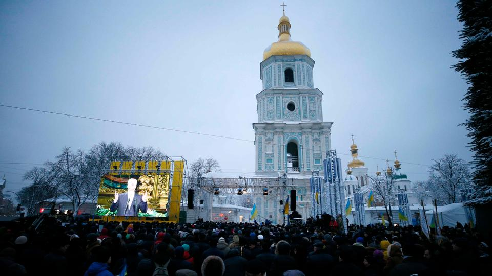 Ukrainian believers gather at the front of the Saint Sophia's Cathedral during church council to convene to create an independent Ukrainian Orthodox church in Kiev, Ukraine on December 15, 2018.