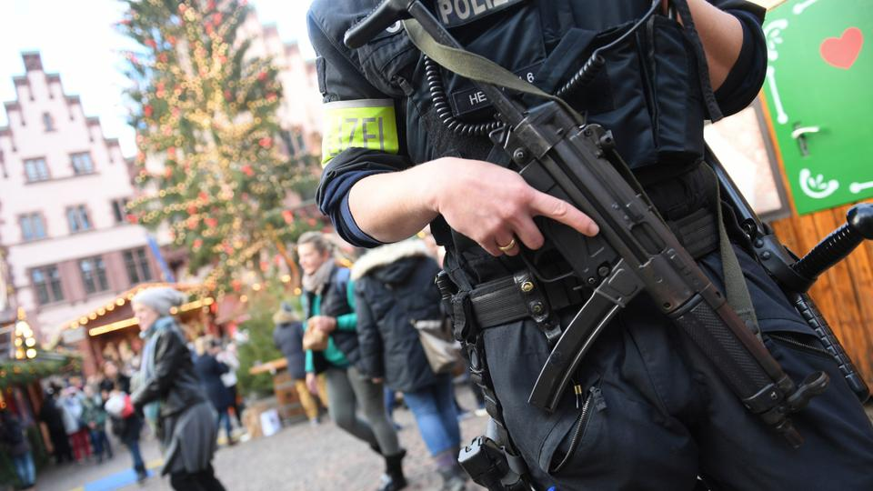 The four male and one female officers in Frankfurt have been suspended from their duties during an ongoing investigation.