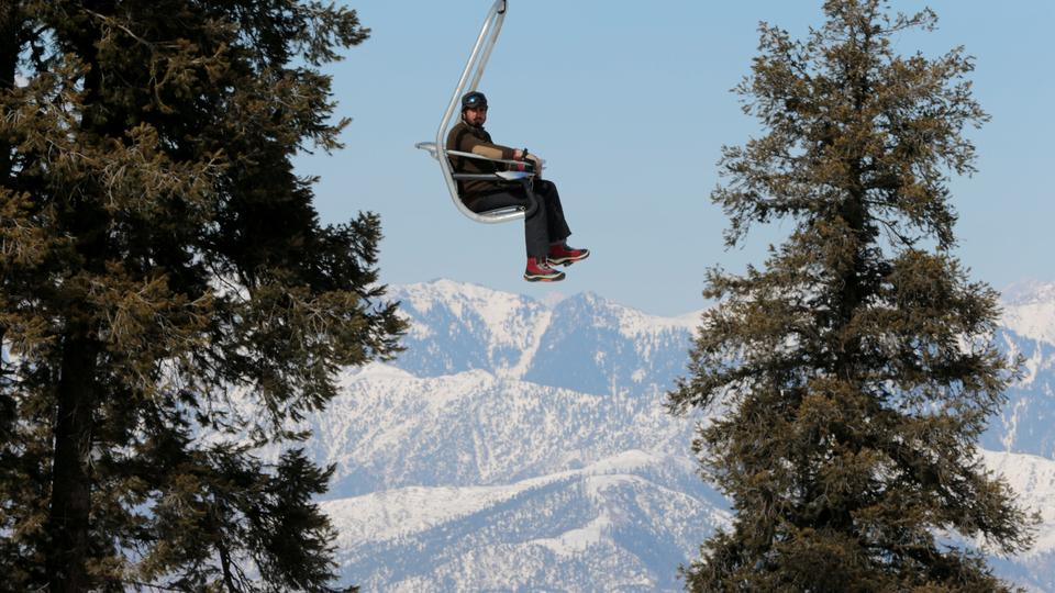 A man rides the chair lift at the ski resort in Malam Jabba, Pakistan February 7, 2017.