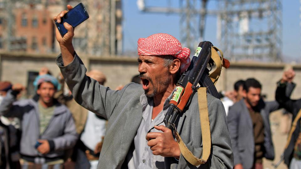 A Yemeni man holds an AK-47 as people gather in the capital Sanaa to show their support to the Houthi movement against the Saudi-led intervention, on December 19, 2018.