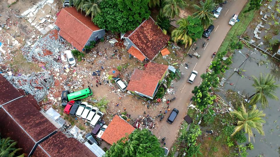 An aerial photo shows damaged buildings in Carita on December 23, 2018, after the area was hit by a tsunami on December 22.
