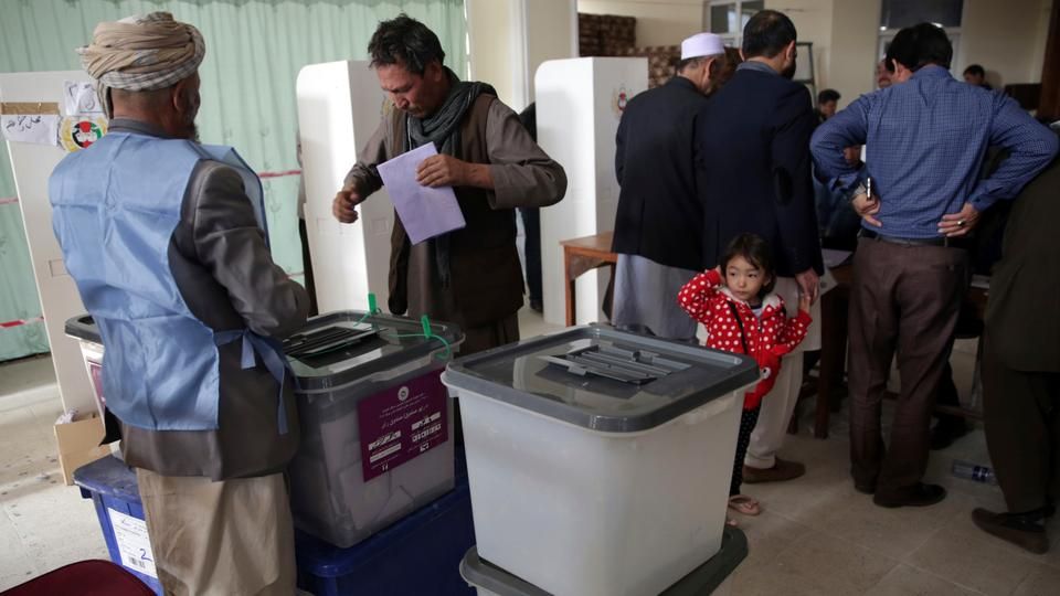 A man prepares to cast his vote during the second day of Parliamentary elections in Kabul, Afghanistan, on October 21, 2018.