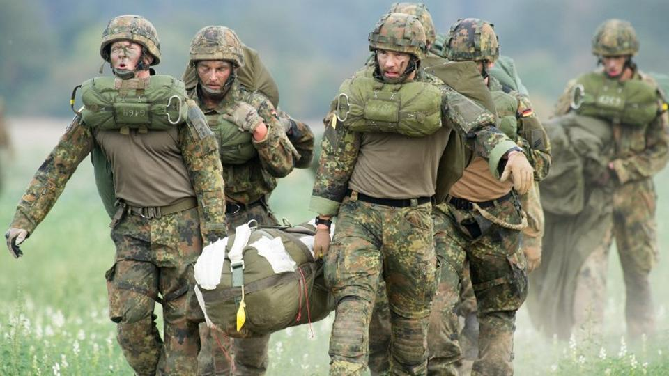 In this file photo taken on September 10, 2018 members of the Rapid Forces Division (DSK) take part in the Fast Eagle 2018 military evacuation exercise of German armed forces Bundeswehr at Borstel airport. Germany's military chief said on December 27, 201