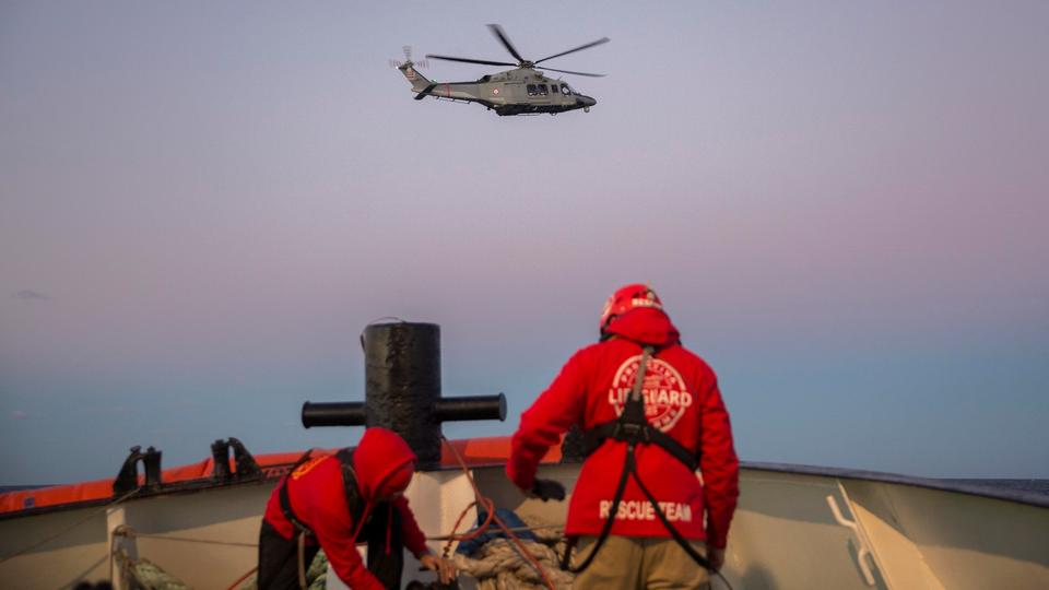 A rescue helicopter leaves after evacuating a mother and her new born baby following their rescue with other nearly 300 migrants off the coast of Libya on December 21, 2018 by Proactiva Open Arms organisation.