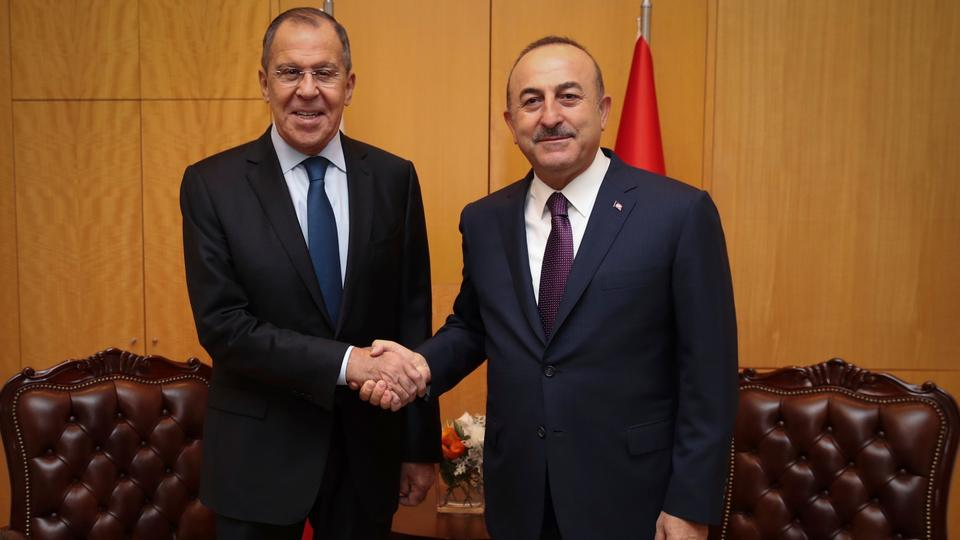 Turkey's Foreign Minister Mevlut Cavusoglu (R) shakes hands with Russia's Foreign Minister Sergei Lavrov prior to a meeting in Istanbul. October 27, 2018.