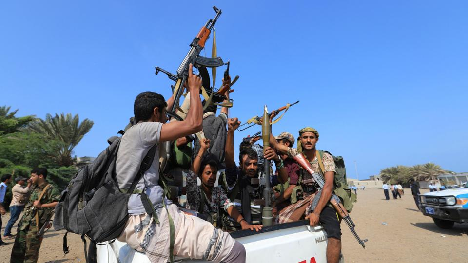 Houthi rebels ride on the back of a truck as they withdraw, part of a UN-sponsored peace agreement signed in Sweden earlier this month, from the Red Sea city of Hudaida, Yemen. December 29, 2018.