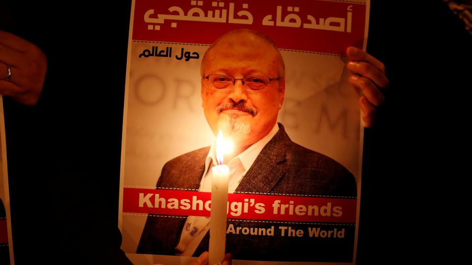 A demonstrator holds a poster with a picture of Saudi journalist Jamal Khashoggi outside the Saudi Arabia consulate in Istanbul, Turkey on October 25, 2018.