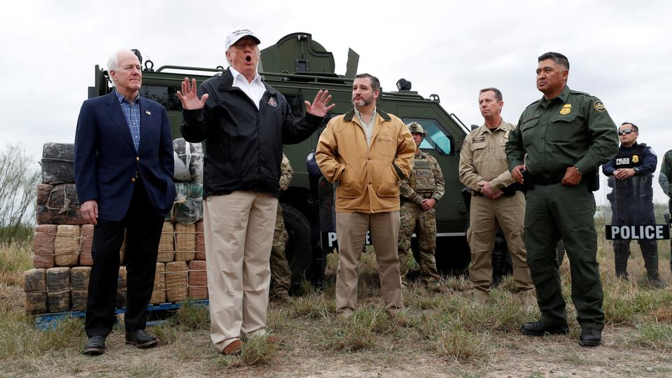 Donald Trump speaks to reporters as he visits the banks of the Rio Grande River with Senator John Cornyn, Senator Ted Cruz and US Customs and Border Patrol agents during the president's visit to the US-Mexico border in Mission, Texas, US. January 10, 2019.