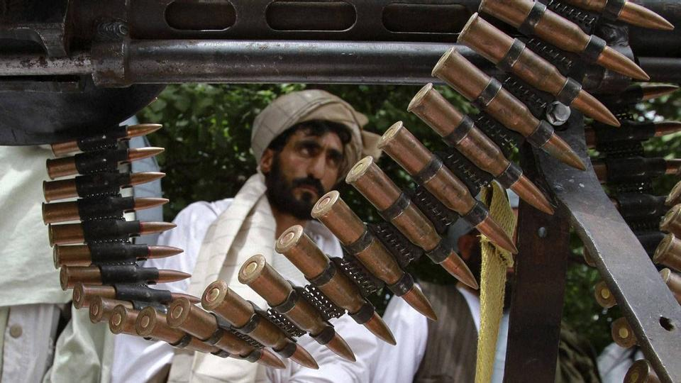Taliban militants hand over their weapons after joining the Afghan government's reconciliation and reintegration program, in Herat province on May 14, 2012