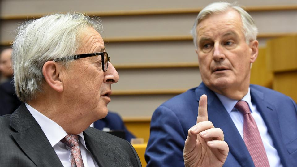 President of the European Union Commission Jean-Claude Juncker (L) speaks with European Chief Brexit negotiator, Michel Barnier (R) during a session of the parliament at the EU headquarters, in Brussels, on January 30, 2019.