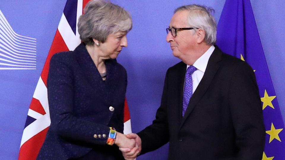 European Commission President Jean-Claude Juncker shakes hands with British Prime Minister Theresa May at the European Commission headquarters in Brussels, Belgium, February 7, 2019