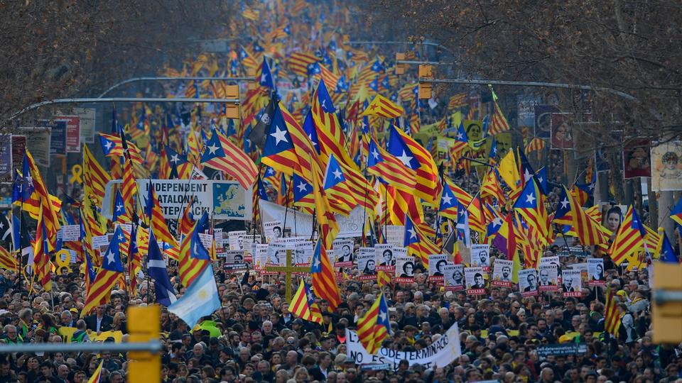 Demonstrators wave Catalan pro-independence Estelada flags during a protest against the trial of former Catalan separatist leaders in Barcelona on February 16, 2019.