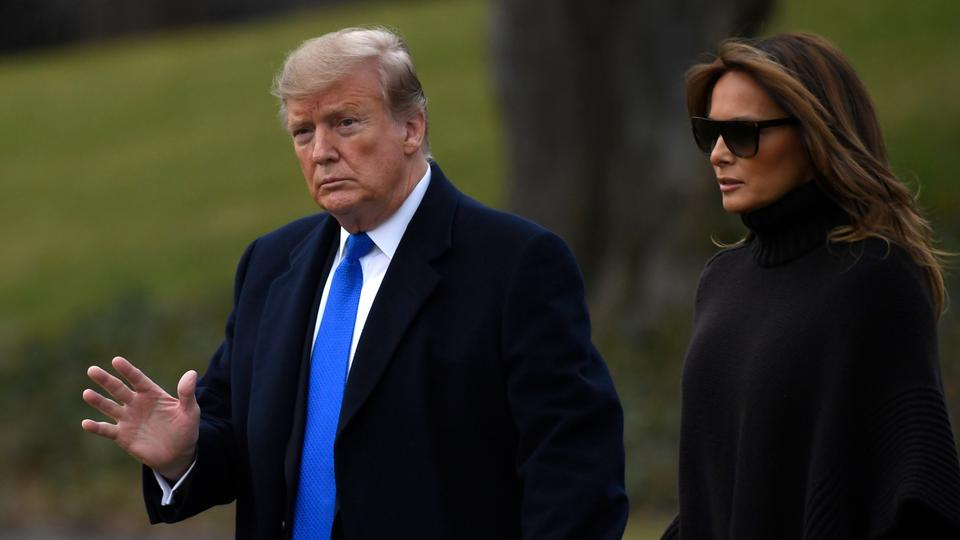US President Donald Trump and first lady Melania Trump walk to Marine One on the South Lawn of the White House in Washington. February 15, 2019.