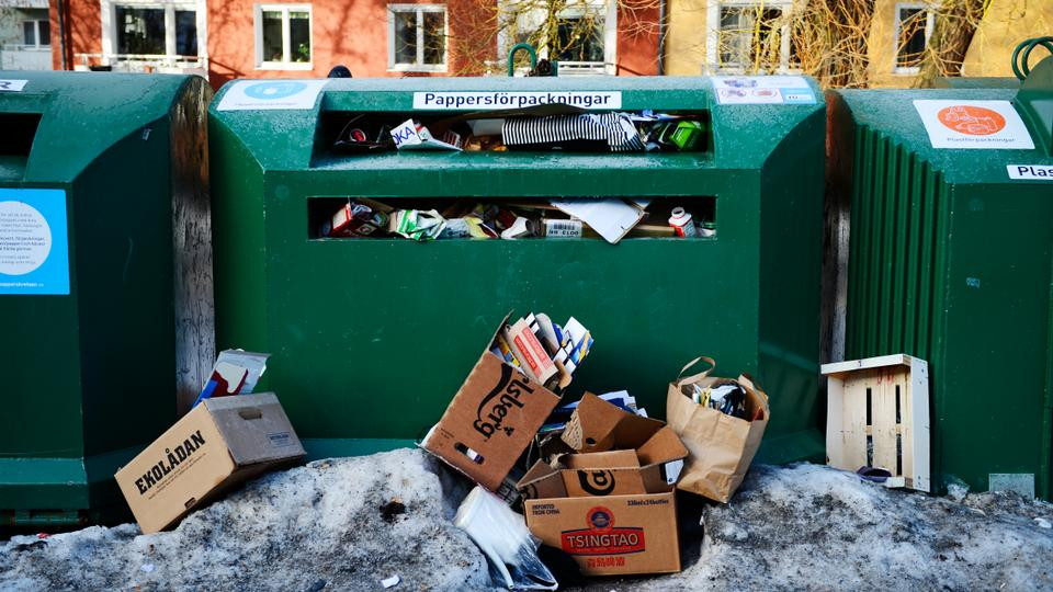 Recycling containers for paper packages are pictured in Hokarangen, south of Stockholm on February 1, 2013.