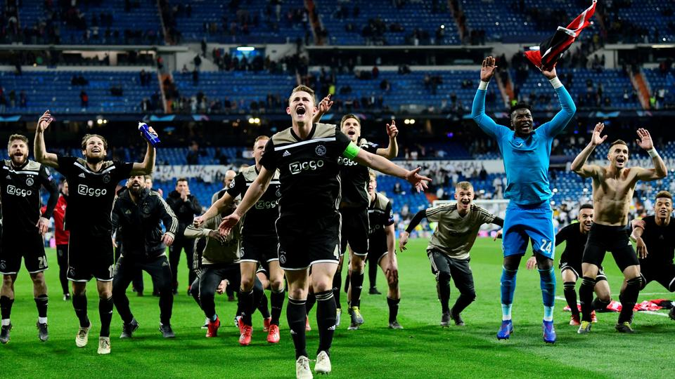 3bcccc1ab52d9 Ajax s players celebrate at the end of the UEFA Champions League round of  16 second leg