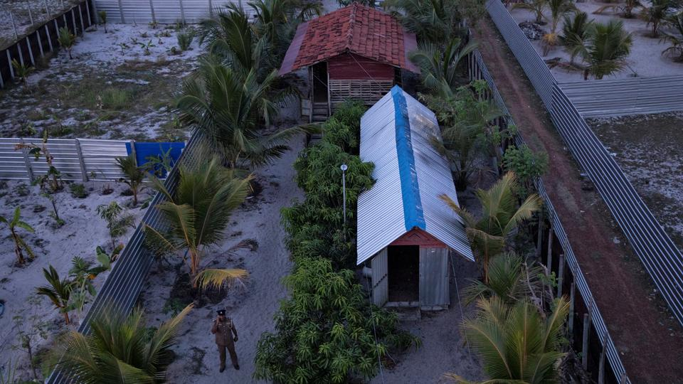 A police officer stands inside a training camp allegedly linked to militants in Kattankudy, near Batticaloa, Sri Lanka, on May 5, 2019.