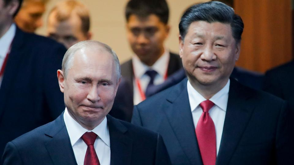 Russian President Vladimir, left, and Chinese President Xi Jinping arrive to attend a plenary session at the St. Petersburg International Economic Forum in St. Petersburg, Russia, on June 7, 2019.