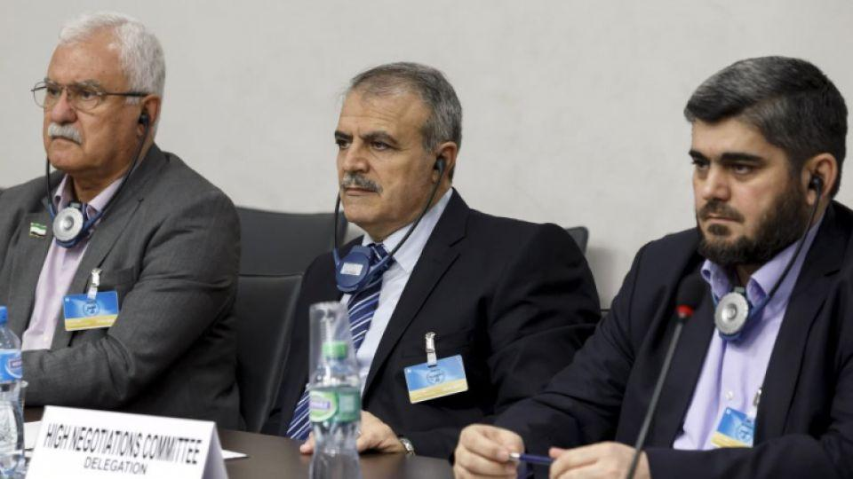 Members of the Syrian opposition delegation of the High Negotiations Committee (HNC) George Sabra (2nd L) delegation head Asaad Al Zoubi (C) and Chief negotiator, Army of Islam opposition group's Mohammed Alloush during peace talks at the UN, Geneva.