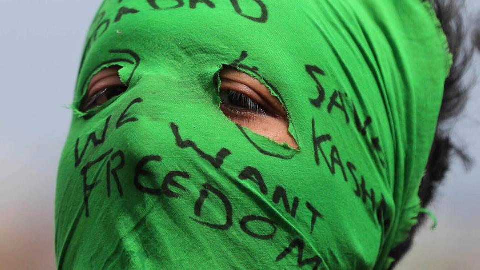A masked Kashmiri protester shouts pro-independence slogans in Srinagar, India-administered Kashmir, Friday, August 30, 2019.
