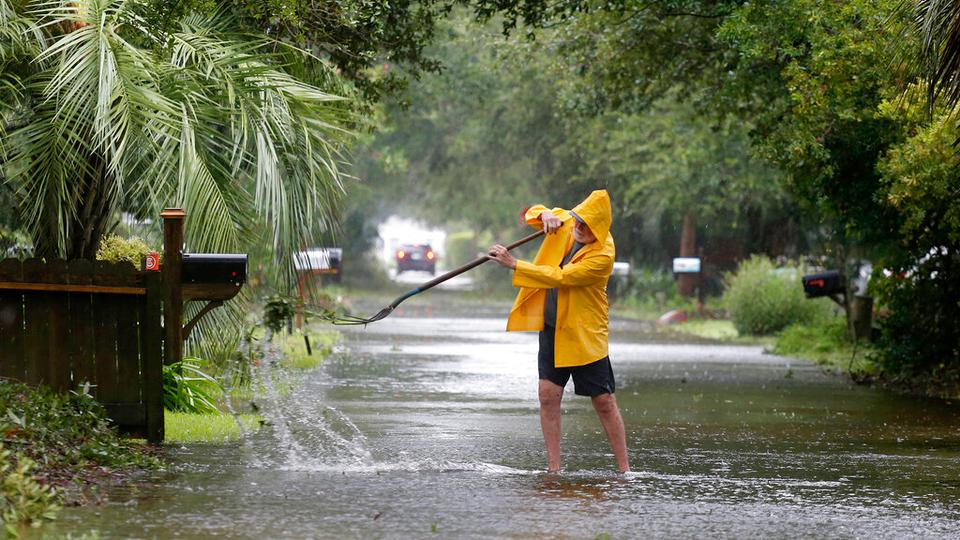 An Isle of Palms resident clears the drain during Hurricane Dorian in South Carolina, USA on September 5, 2019.