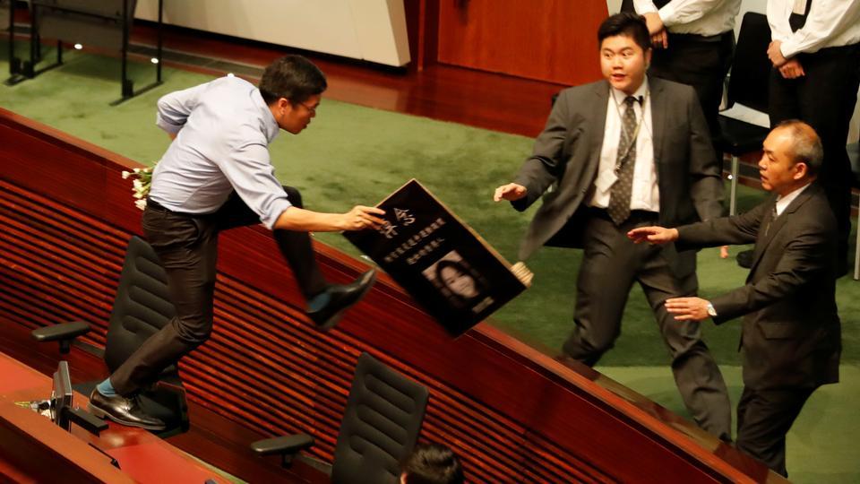 Hong Kong legislative session adjourned amid protests and heckling