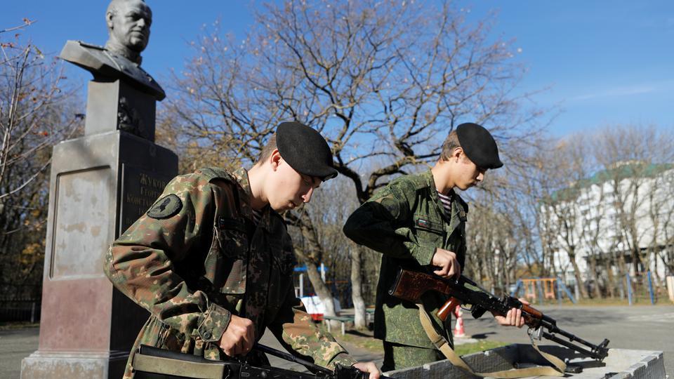 Students of the General Yermolov Cadet School assemble a Kalashnikov assault rifle and a machine gun during a demonstration lesson marking the upcoming Russian gunsmith Mikhail Kalashnikov's 100th anniversary of birth in Stavropol, Russia November 8, 2019.