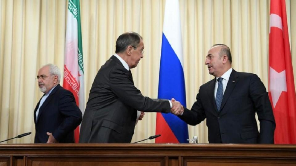 Turkey russia iran sign deal on de escalation zones in syria russian foreign minister sergey lavrov c shakes hands with his turkish counterpart mevlut cavusoglu platinumwayz