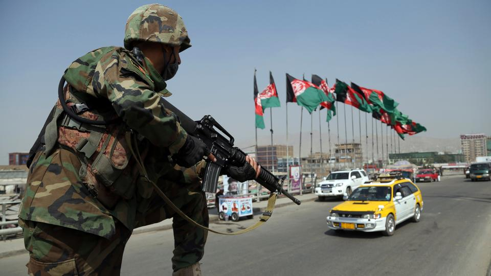 An Afghan National Army soldier stands guard at a checkpoint on September 24, 2019 ahead of presidential elections scheduled for September 28, in Kabul, Afghanistan.