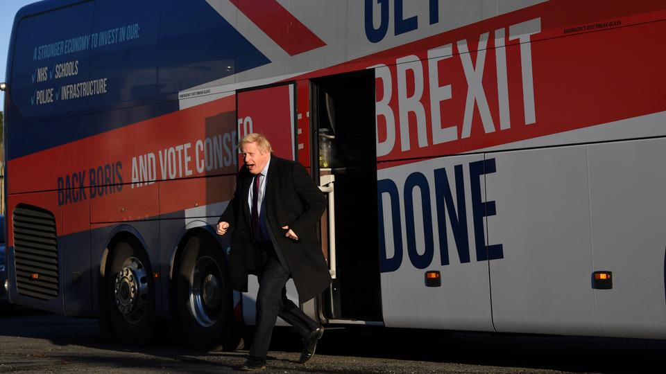 Britain's Prime Minister and Conservative leader Boris Johnson gets off the 'battle bus' as he arrives for a general election campagin visit to Furgusons Transport in the town of Washington, west of Sunderland, northeast England. December 9, 2019.
