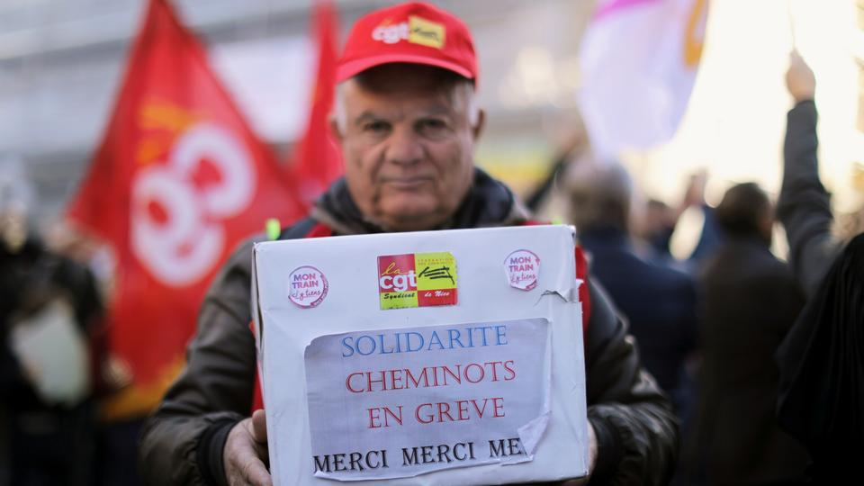 A man holds a box to collect funds for the strikers during the 36th consecutive day of the strike against the French government's pensions reform plans, in Nice, France, January 9, 2020.