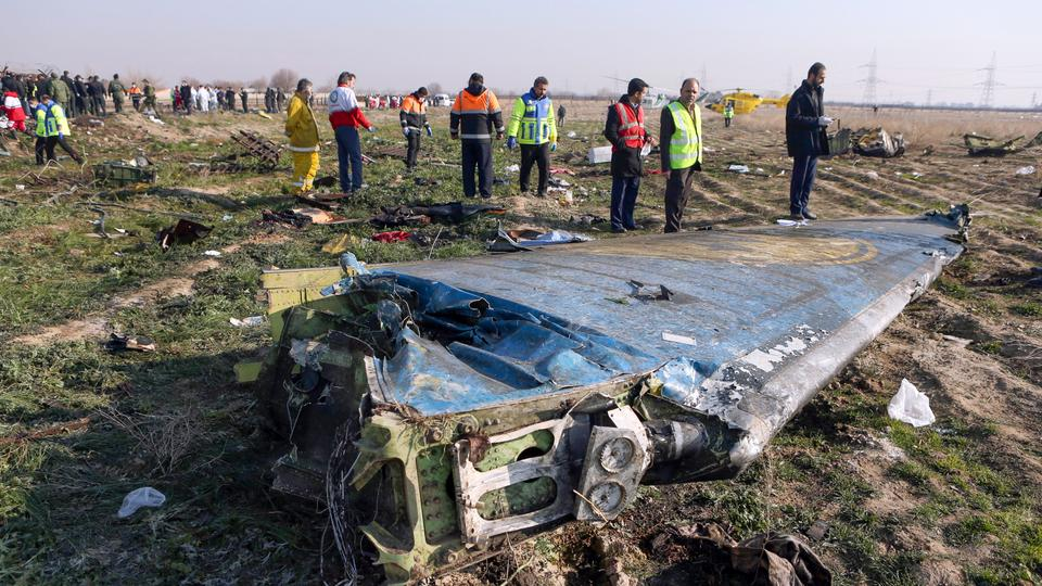 In this file photo taken on January 8, 2020 rescue teams are seen at the scene of a Ukrainian airliner that crashed shortly after take-off near Imam Khomeini airport in the Iranian capital Tehran. Iran said on January 11 that it unintentionally shot down the Ukrainian plane due to 'human error'.