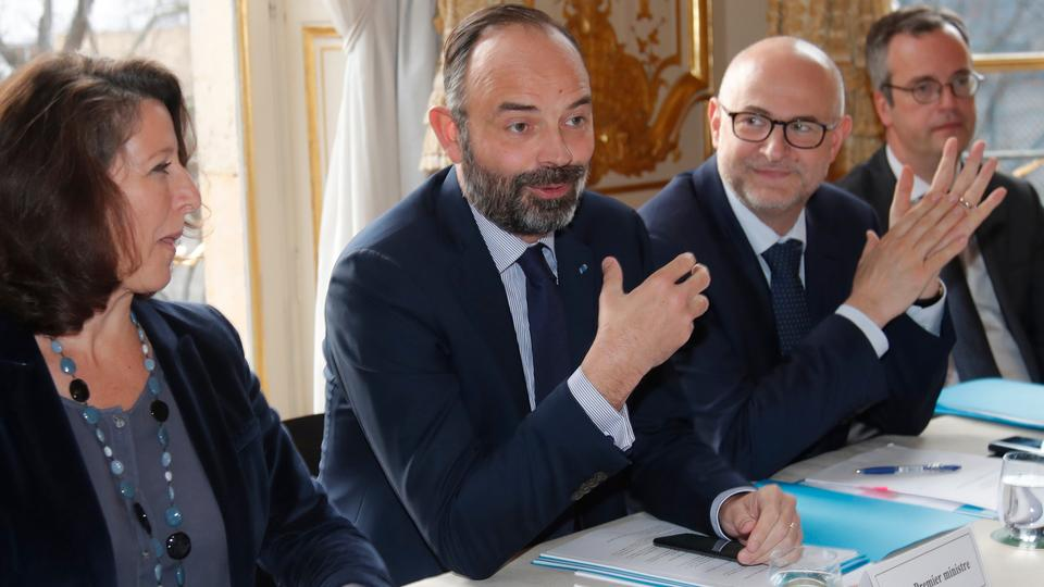 French Prime Minister Edouard Philippe (C) flanked by French Health and Solidarity Minister Agnes Buzyn (L) and French High Commissioner for Pension Reform Laurent Pietraszewski (R), attends a meeting with labour union leaders at the Hotel Matignon in Paris, on January 10, 2020, over the government's pensions overhaul.
