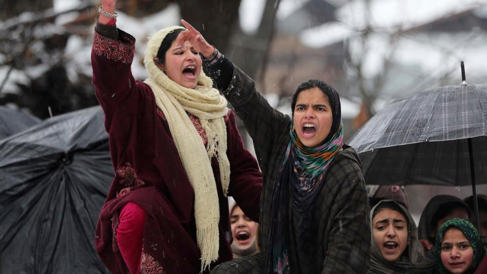 Kashmiri women shout pro-independence slogans during the funeral of top rebel commander Umar Fayaz in village Tral, south of Srinagar, India-administered Kashmir, Monday, Jan 13, 2020.