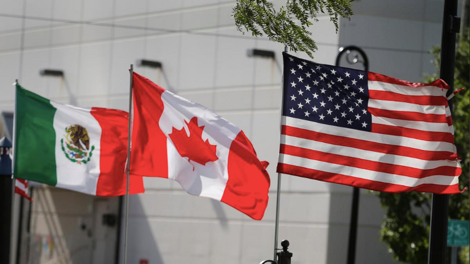 Flags of the US, Canada and Mexico fly next to each other in Detroit, Michigan, US on August 29, 2018.