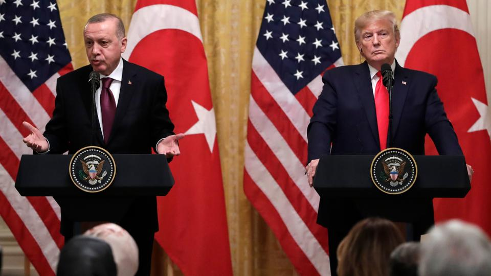 President Donald Trump listens as Turkish President Recep Tayyip Erdogan speaks during a news conference in the East Room of the White House, Wednesday, Nov. 13, 2019, in Washington.