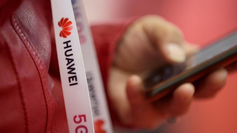 An attendee wears a badge strip with the logo of Huawei and 5G at the World 5G Exhibition in Beijing, China. November 22, 2019.