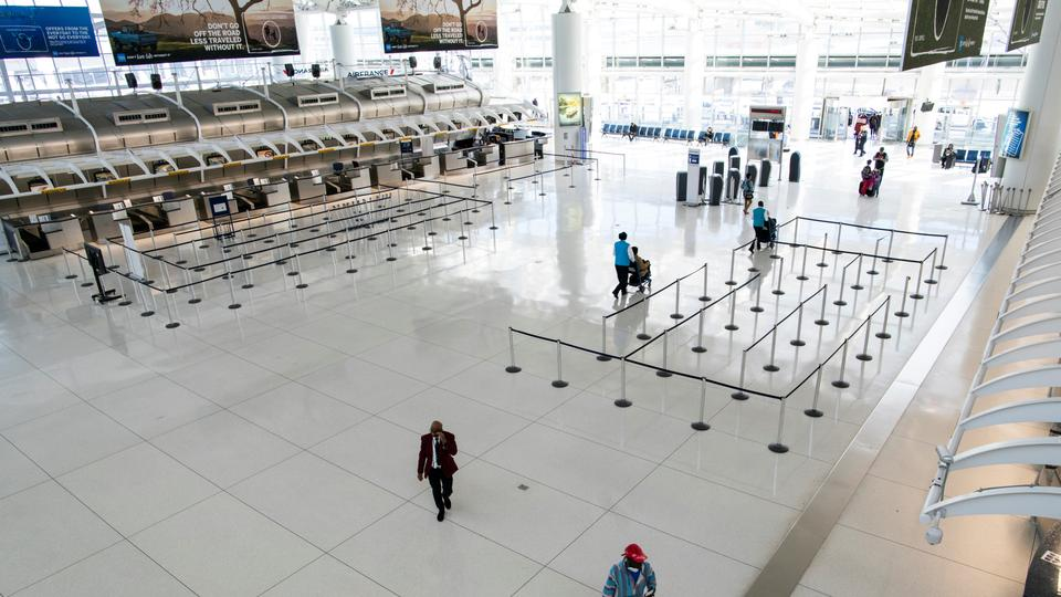 People walk around the terminal at the John F. Kennedy International Airport in New York, U.S., March 9, 2020.