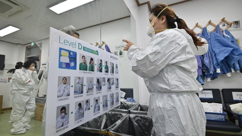 South Korea leads virus success in Asia as drug trial raises hope