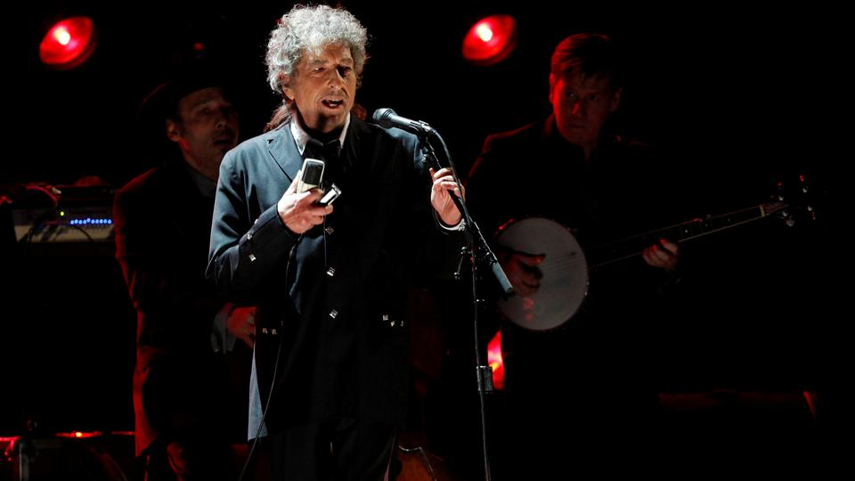 Singer Bob Dylan performs during a segment honoring Director Martin Scorsese, recipient of the Music+ Film Award, at the 17th Annual Critics' Choice Movie Awards in Los Angeles , US on January 12, 2012.