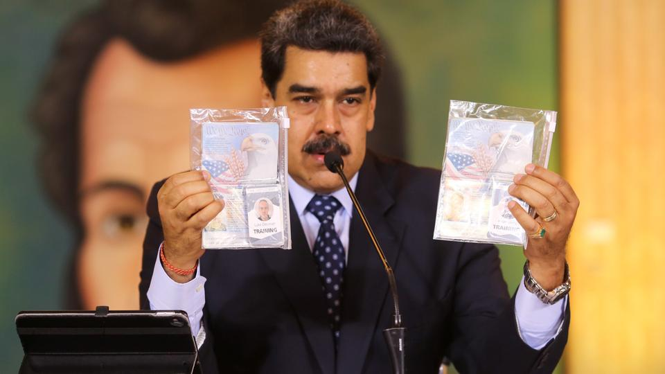 Personal documents are shown by Venezuela's President Nicolas Maduro during a virtual news conference in Caracas, Venezuela on May 6, 2020.